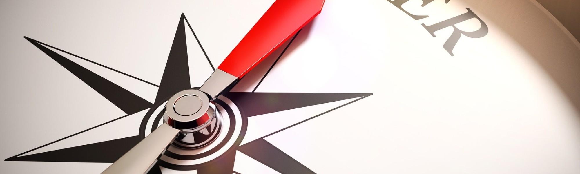 Kuvassa kompassi ja sana Career