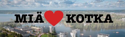 Kuvassa on ilmakuva Kotkasta ja Miä sydän Kotka-logo